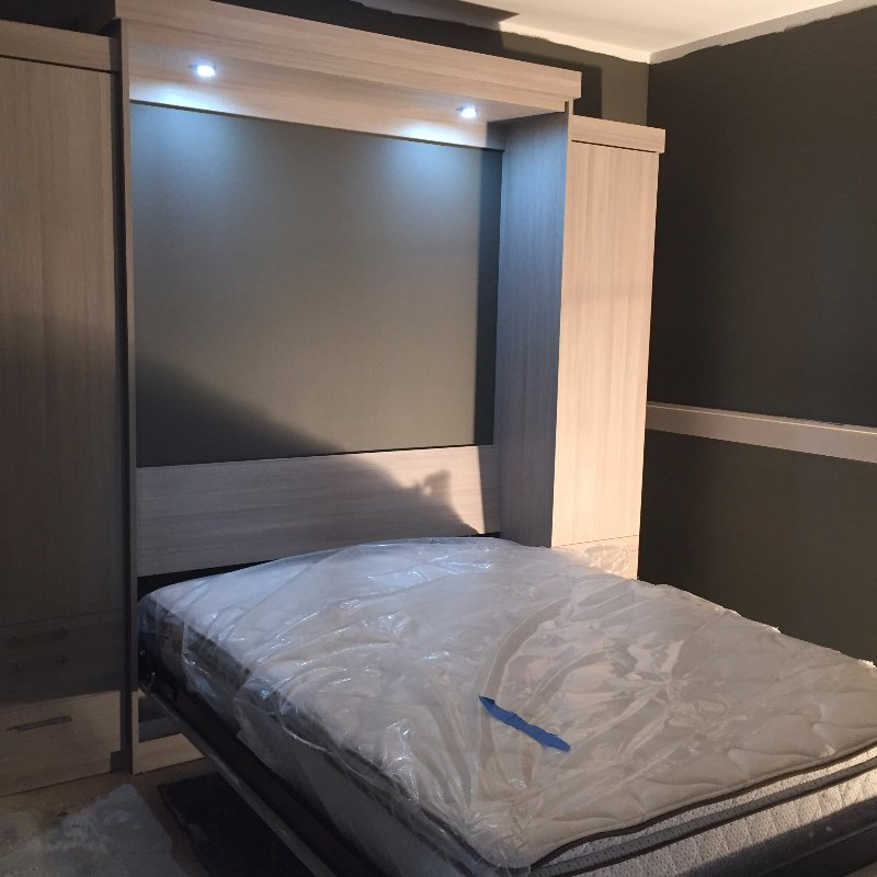 Modern Wall Bed with lighting inside cabinets down