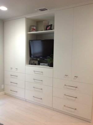 modern entertainment center with drawers and doors