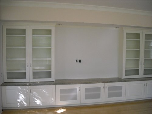 large painted entertainment center  with granite top and speaker cloth doors