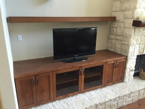 cherry entertainment center with floating shelf above