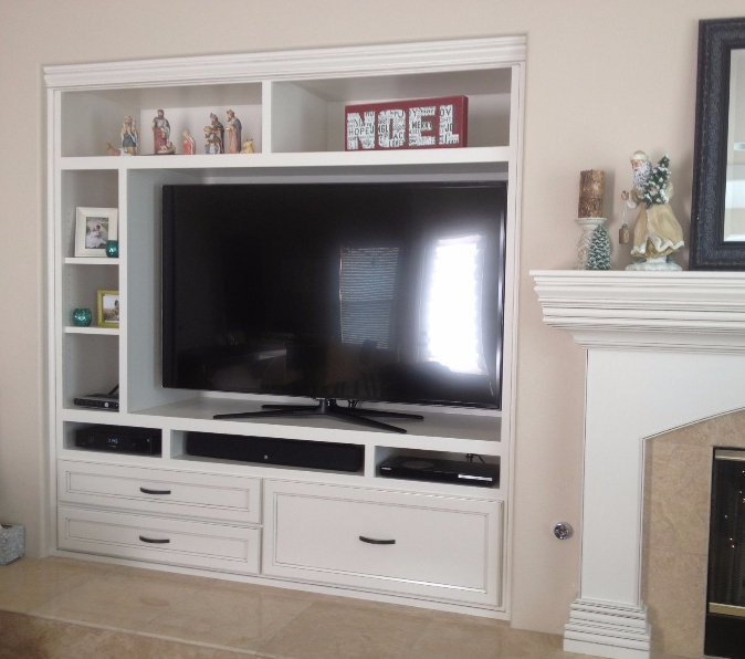 large entertainment center with under storage, drawers, and doors