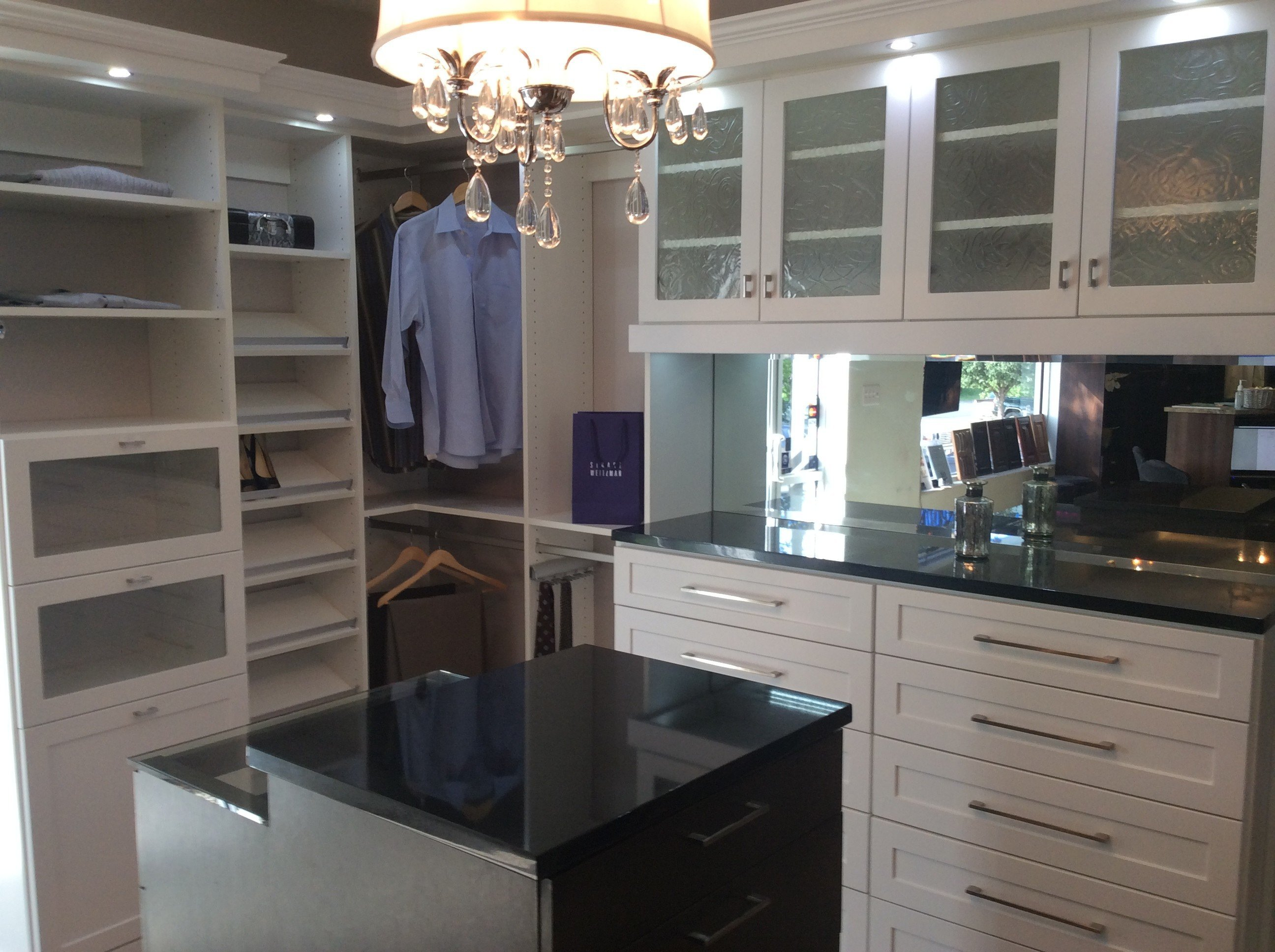 white shaker closet with veneer wood island