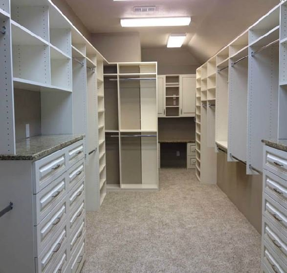long narrow closet with office desk in rea