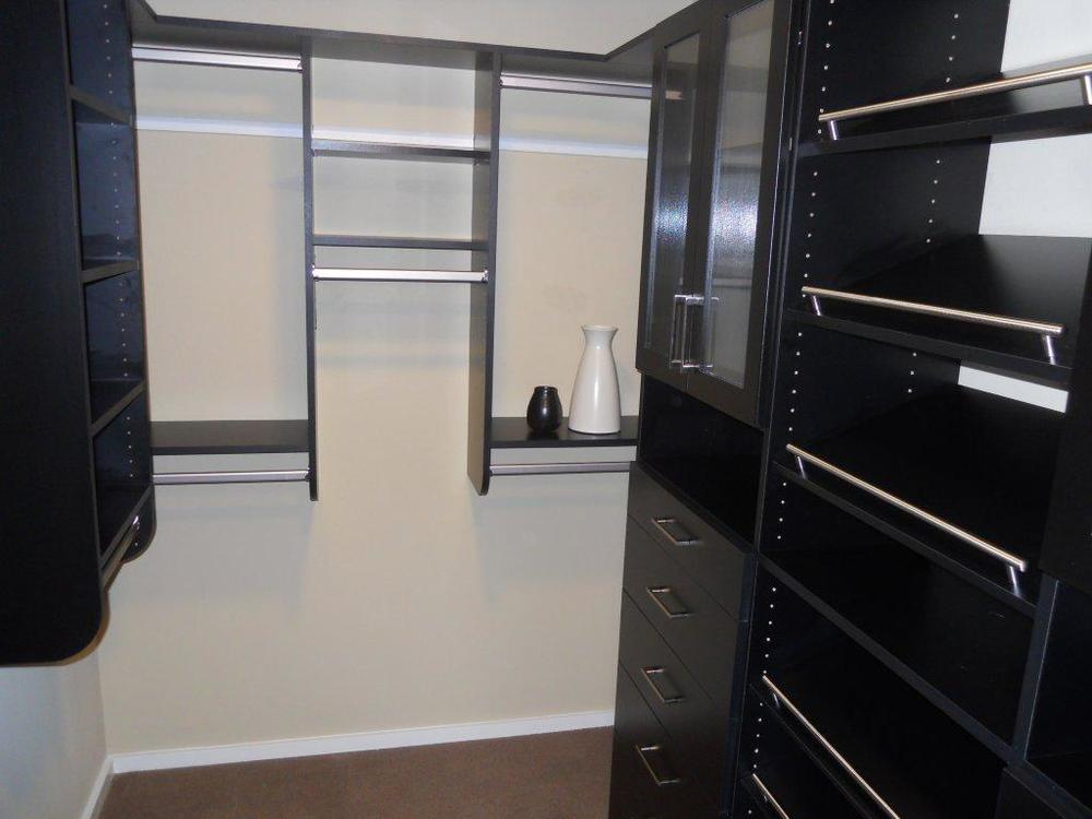 black high gloss closet with slanted shoe shelves