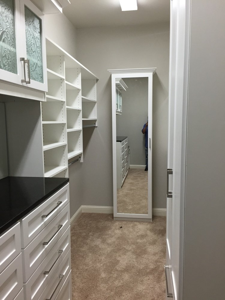 long narrow closet with mirrored door shoe cabinet