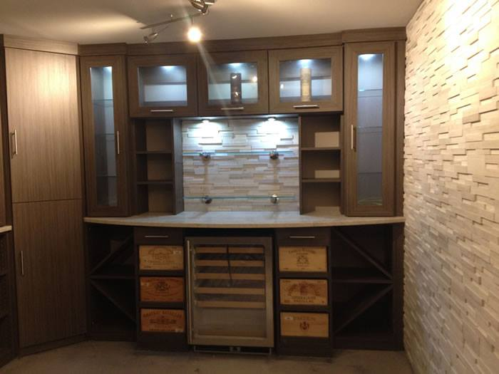 modern wine cellar with slide out wine boxes a refrigerator