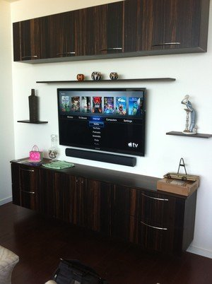 modern floating entertainment center with floating shelves and cabinets