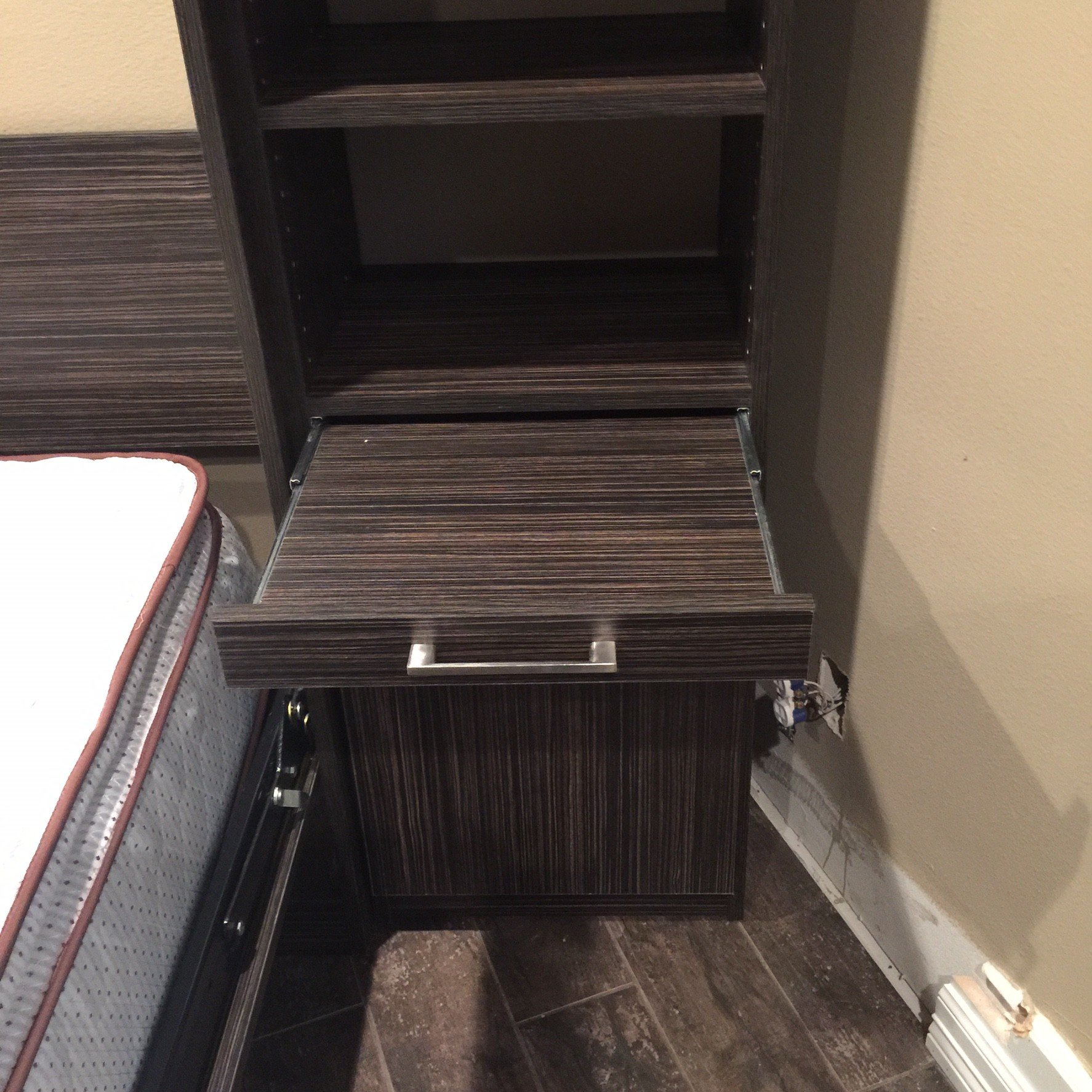 Wall bed with pull out nightstand