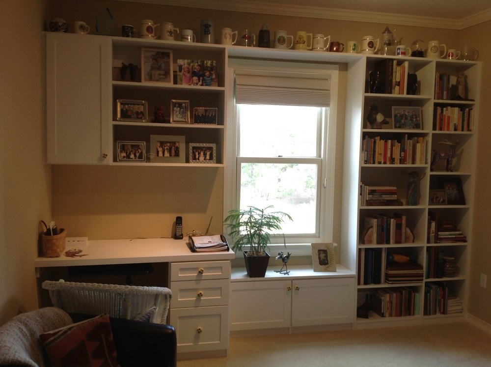 home office around window with side bookshelving