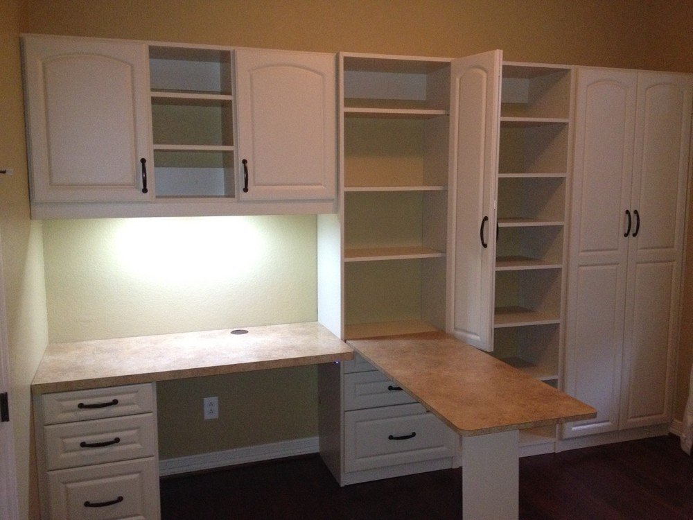 home office with hidden fold down desk in side unit