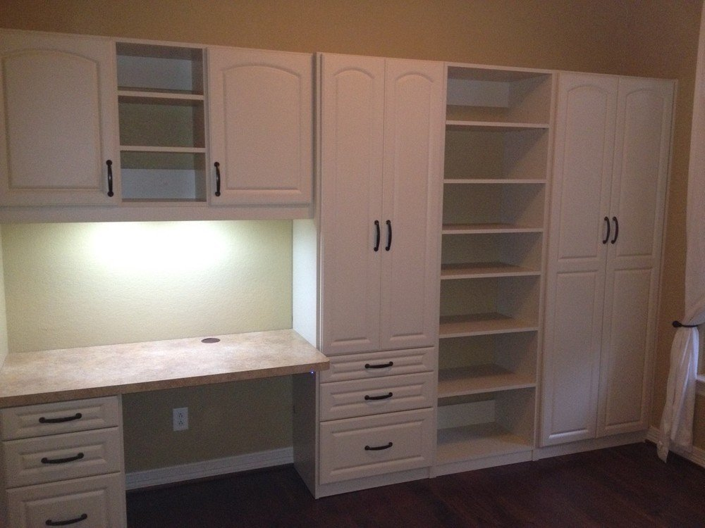 home office with hidden fold down desk in up position