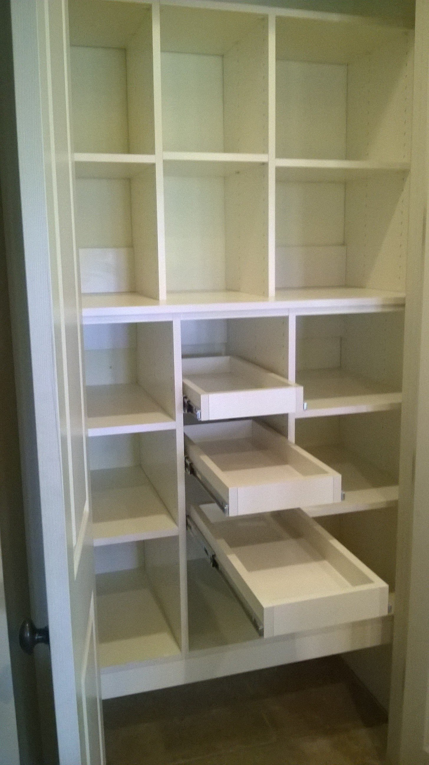 small pantry with adjustable and slide out shelves