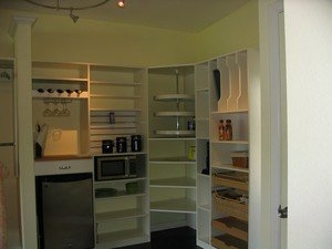 pantry with vertical pan storage