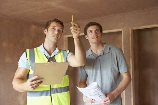 Interior of the house being surveyed by expert