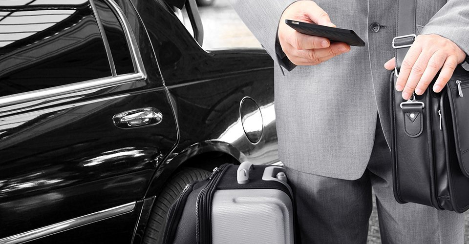 businessman using airport transfer