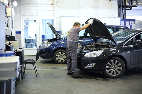 Professional repairing an automobile in Columbia, MO