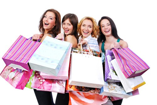 Happy women with shopping bags isolated on white
