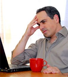 mortage-advisors-nottingham-the-independent-mortgage-shop-stressed-man-with-laptop