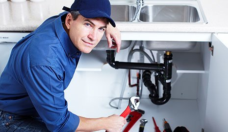A plumbing services expert at work in Enterprise, AL