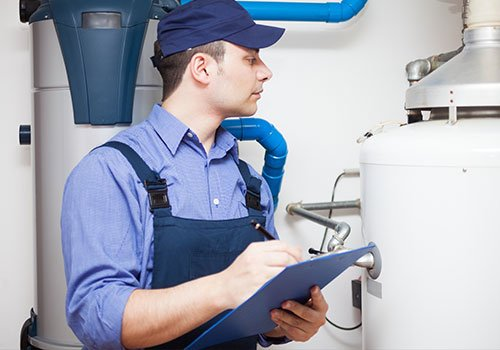 Our employee doing hot water heater repair service in Enterprise, AL