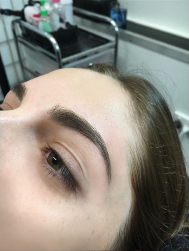 the makeup mirror eye brow lining by a stylist