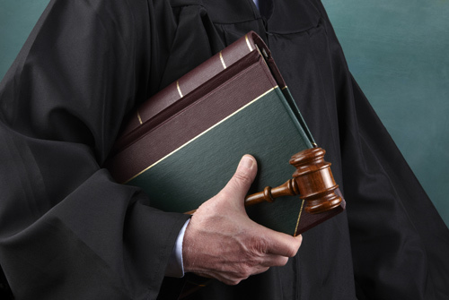 Wills and trusts lawyer holding law documents in Galesburg, IL