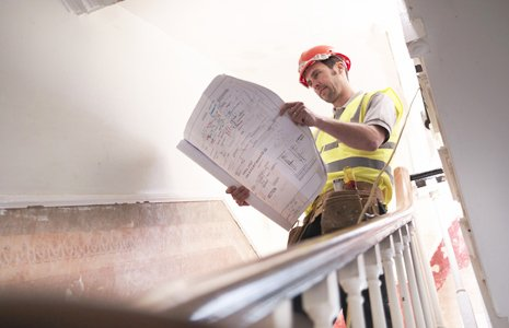 worker reading building plan