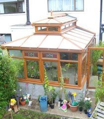 a conservatory with wooden frame windows