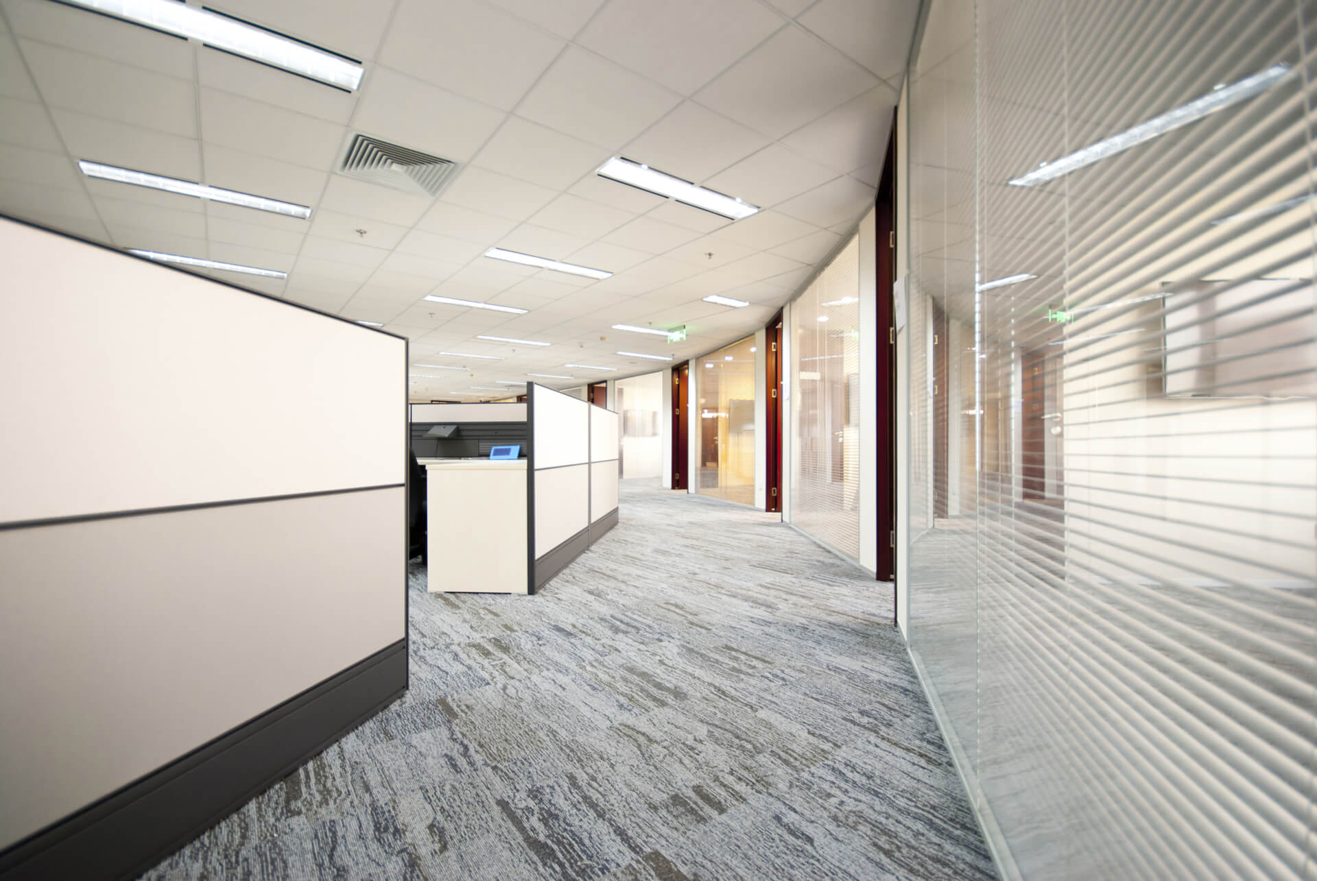 Glass office partitions with suspended ceilings & lighting