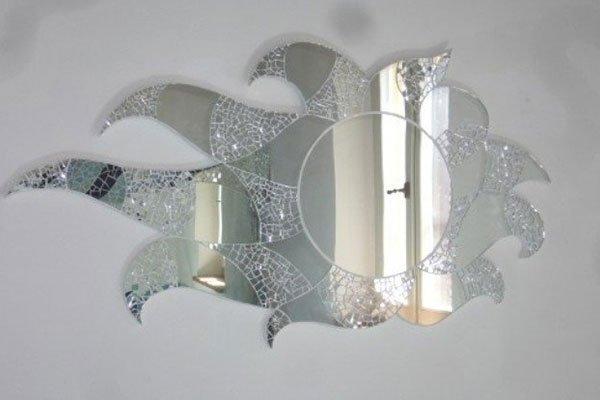 Specchio tondo con raggi costituiti da minuscoli specchi