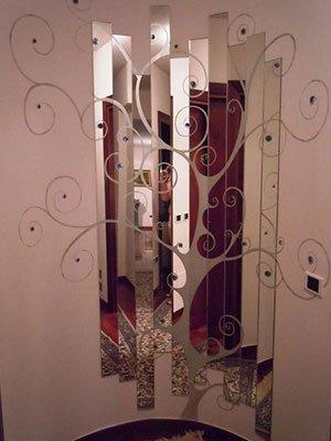 Arbol progettato con laminate a specchio