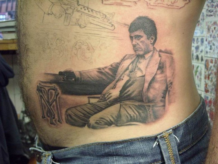 tattoo of a man sitting in his suit