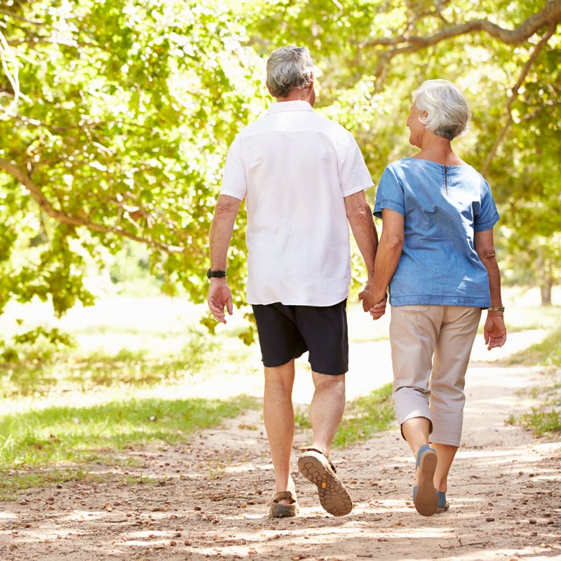 Old couple walking in their estate