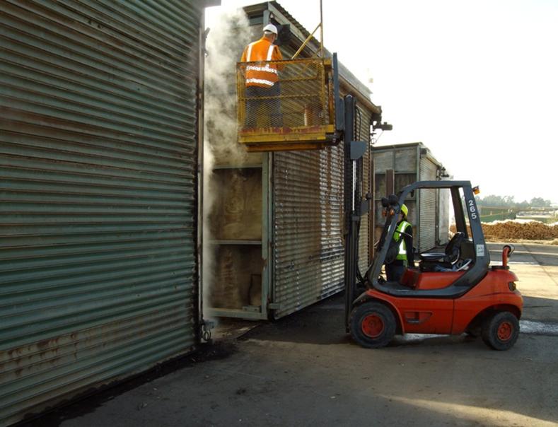 Professionals using garage door parts to fix roller door