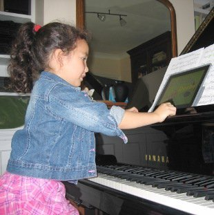 Young child learning the piano