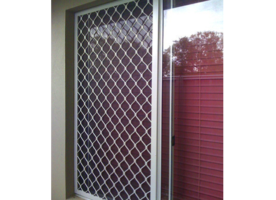 diamond grille security screen window on house