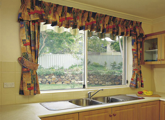 security window in kitchen with curtains