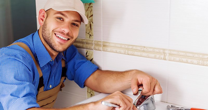 Plumber fixing the sink tap