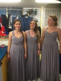 Group of women trying grey colour long dresses