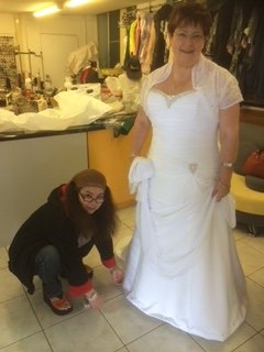 Women trying on bridal dresses