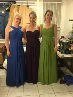 Friends wearing long dresses