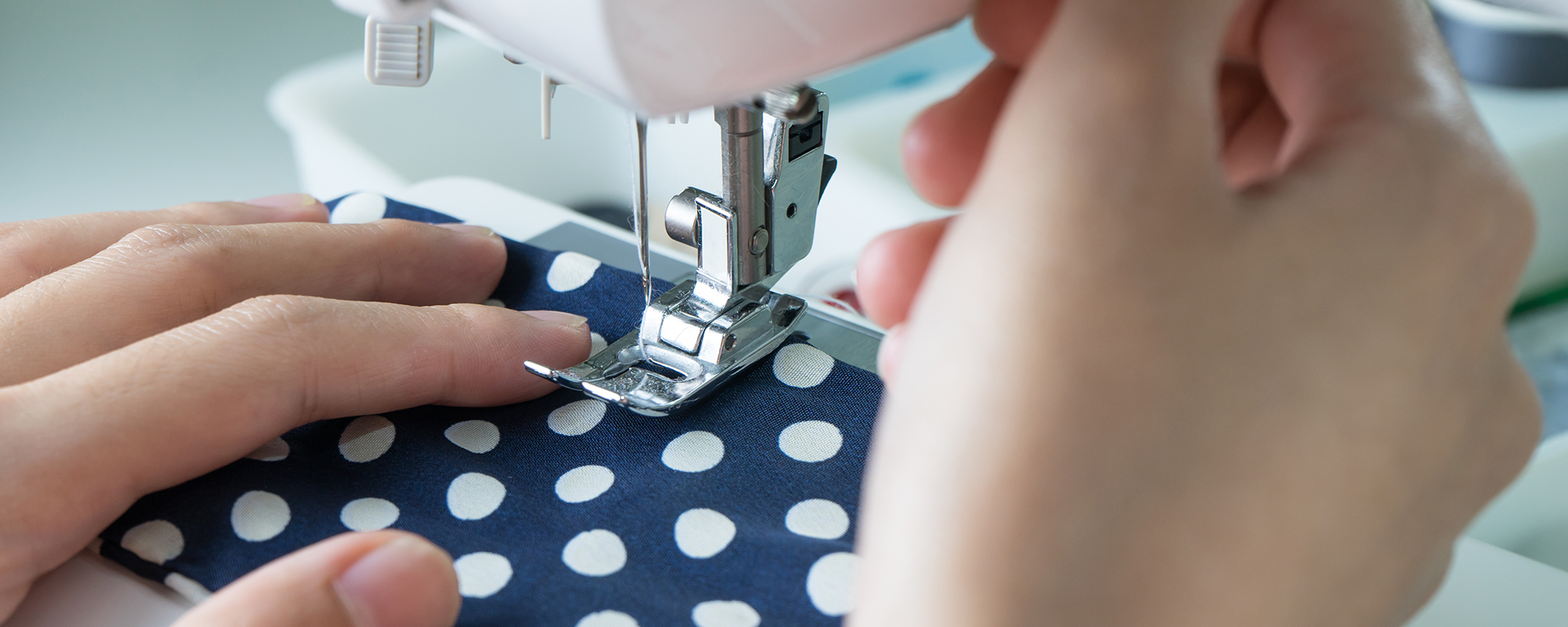 White polka dot cloth being altered