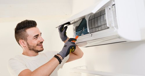 Air conditioner being repaired by professional in in Lincoln
