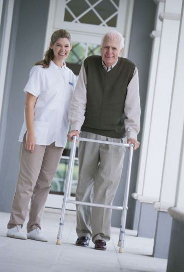 Woman assisting man with home care services in Milford, OH