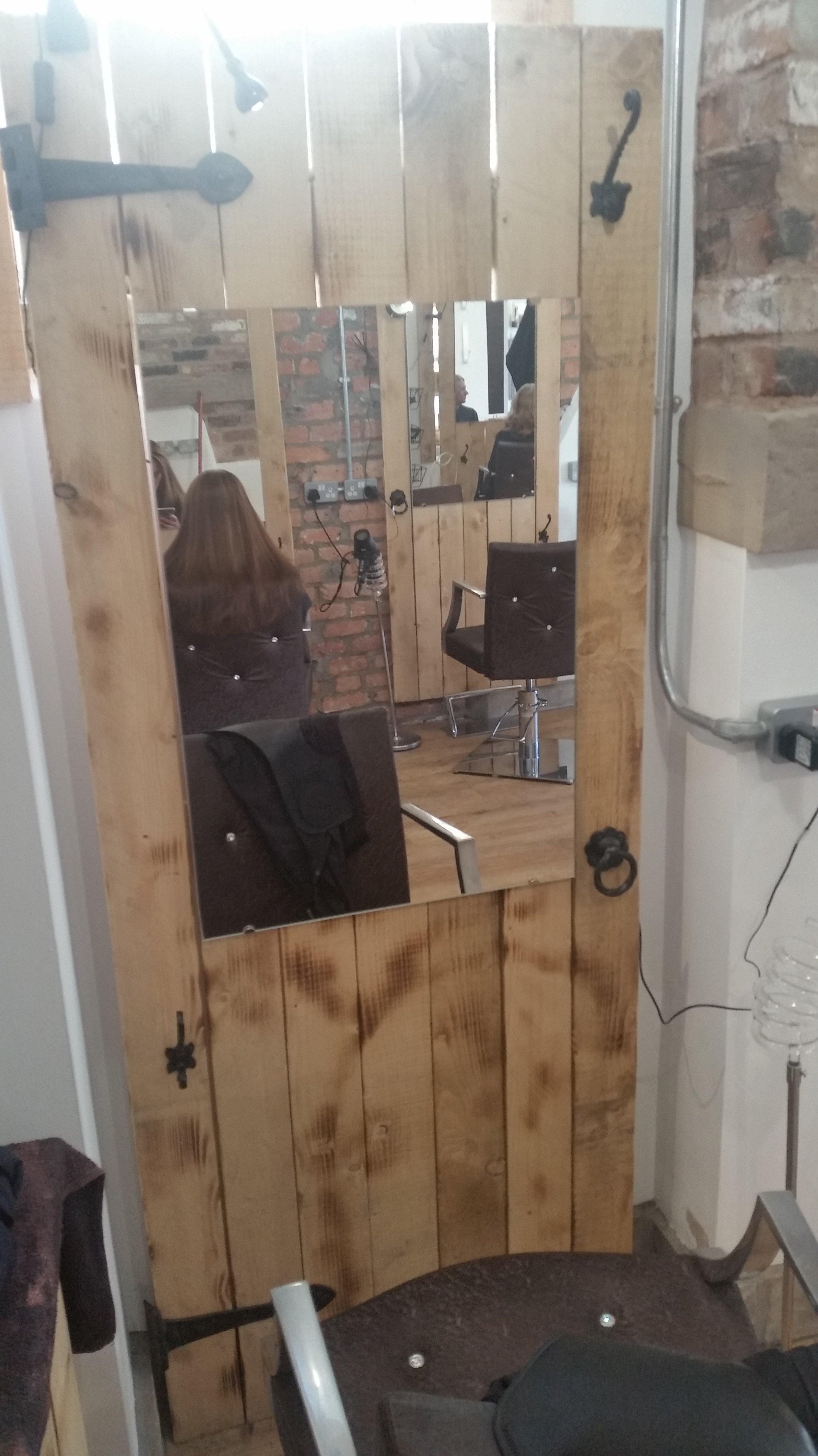 mirror amidst the wooden door