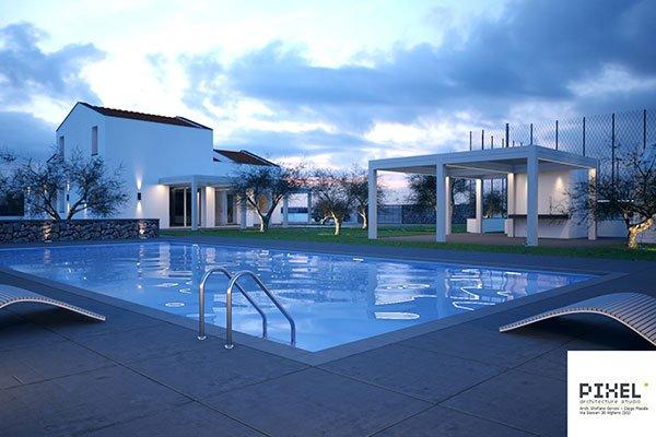 vista di una piscina e in lontananza di alcune case