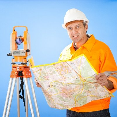 Man reviewing plans and surveying land