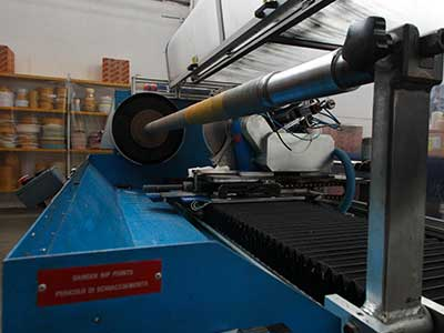 macchina per produzione adesivi
