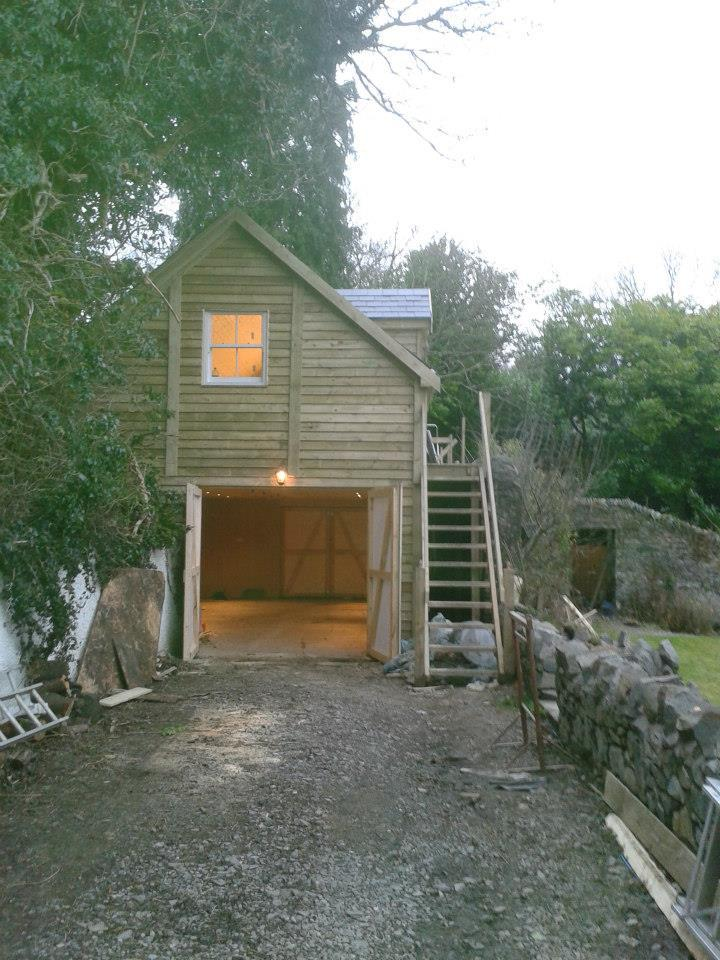 barn with living accommodation above and stairway access