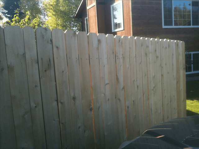 Plain wooden fence without paint prior to working with A & G Painting in Anchorage, AK